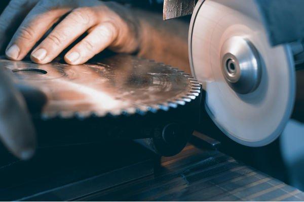 industrial sharpening - hand on blade
